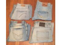 4 pairs of worn men's sandblasted jeans. Various sizes. All in good condition