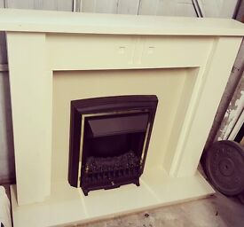 Electric fire and marble surround