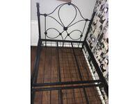 Black single cast iron bed
