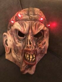 Scary mask with flashing lights.