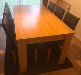 Dining table and 6 leather chairs for sale in great condition delivery available
