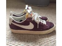 Size 4.5 / 4 distressed Nike trainers