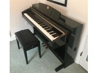 Black Yamaha Clavinova CLP-240/230 piano in excellent condition with adjustable stool included