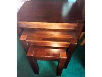 Dark Solid Wood Nest of Three Tables Was Brought For £120