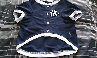 "DOG CLOTHING. AN ""OFFICIAL"" MAJOR LEAGUE BASBALL NEW YORK YANKEE DOG JERSEY."