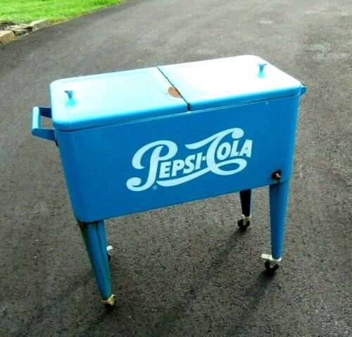 ANTIQUE PEPSI COLA STAND UP COUNTRY STORE COOLER WITH WHEELS AND BOTTLE OPENER