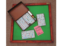 Mah Jongg set with wooden table top playing board.