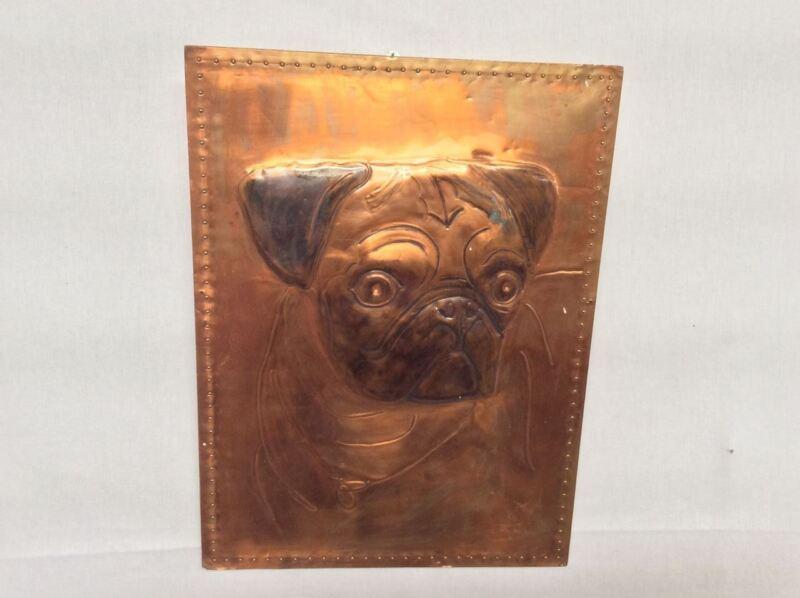 Pug on copper sheet