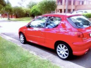 2003 Peugeot 206 GTi - Red, low profile tyres.