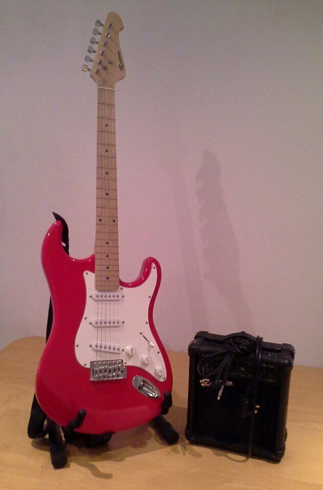 Red Rockburn Guitar with Stand, Amp, and DVD - (HARDLY USED)