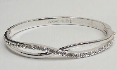 - A11) Anne Klein Pretty Silver-tone & Crystal Hinged Bangle Bracelet