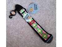 Guitar strap, Dickies, new with tags, bubble gum flower pattern.
