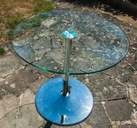 Lovely, tempered glass round table on polished chrome pedestal by by Julian Bowen