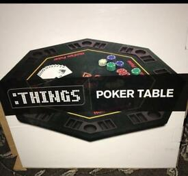 Fold away poker table, with cards and chips.