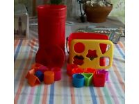 Two different shapes sorters. One is shaped like a post box, the other a fisher Price box.