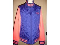 Brand new quilted jacket with detachable sleeves and integrated music player wire