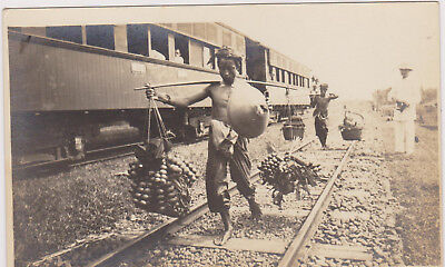 RP: Natives carring fruit to train , DEPOK , RR Depot , JAVA , Indonesia , 00-10