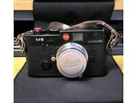 Leica m6 with lens swap dslr hasselbald camera