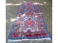 AN OLD & VERY LARGE, HAND WOVEN, ORIENTAL TRIBAL RUG.