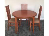 G Plan Solid Teak Circular Extending Dining Table and 3 Matching Tall Chairs. Immaculate condition.