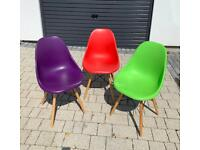 Three colourful Eames style inspired replica dining chairs.