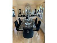 Dining set with Acrylic top with knocker chairs. Brand New and Guaranteed.