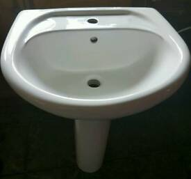 White oval sink and pedalsteed
