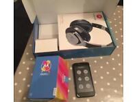 Motorola Moto C Android Phone with Pulse Max Headphones. On Tesco network