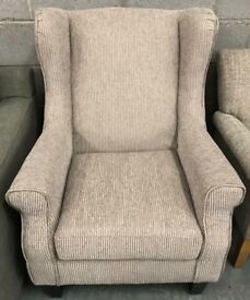 Fabric winged back fireside armchair