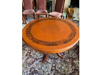Round Dinning room table & 4 chairs The table top always been covered and protected.