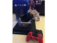 PS4 Pro with games and 2 remotes