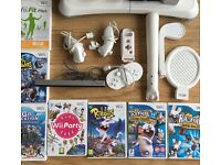 Nintendo wii console with balance board, games, external hard drive with extra games