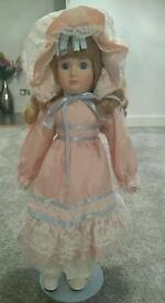 Vintage China doll on stand