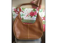 Brown handbag has some sight defects see pics can post