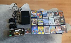 PlayStation 2 with two controllers and 20 games