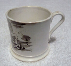 An Antique Staffordshire Bat Printed Child's Mug