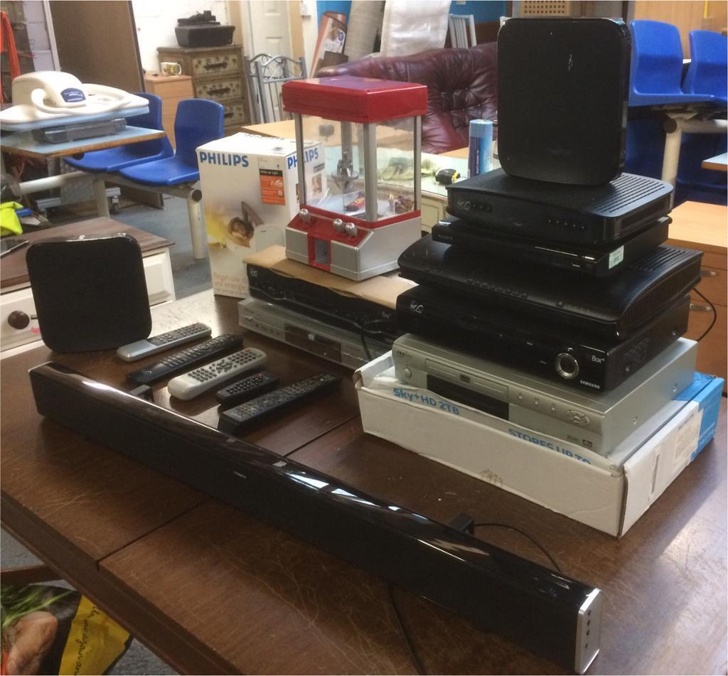 Selection of DVD players,modems,media boxes and sound bar
