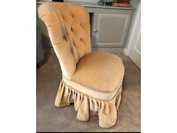 Low chair in cream velvet ideal for bedroom or lounge