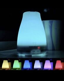 Essential oil diffuser with colour changing lamp / light. Could be used as a night light.
