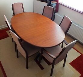 Classic G Plan teak dining table with 4 chairs and 2 carvers.