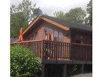 Holiday Lodge in tranquil woodland setting in an elevated position overlooking Lake Bassenthwaite