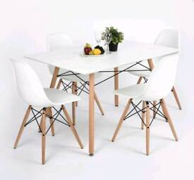 White modern dining table with 4 chairs