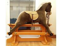 Brand new, never used, childrens rocking horse, relatively large.