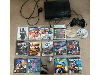 PlayStation 3 slimline console with 16 games
