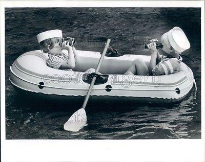 Press Photo Cute Kids in Rubber Raft With Sailor Hats & Binoculars ()