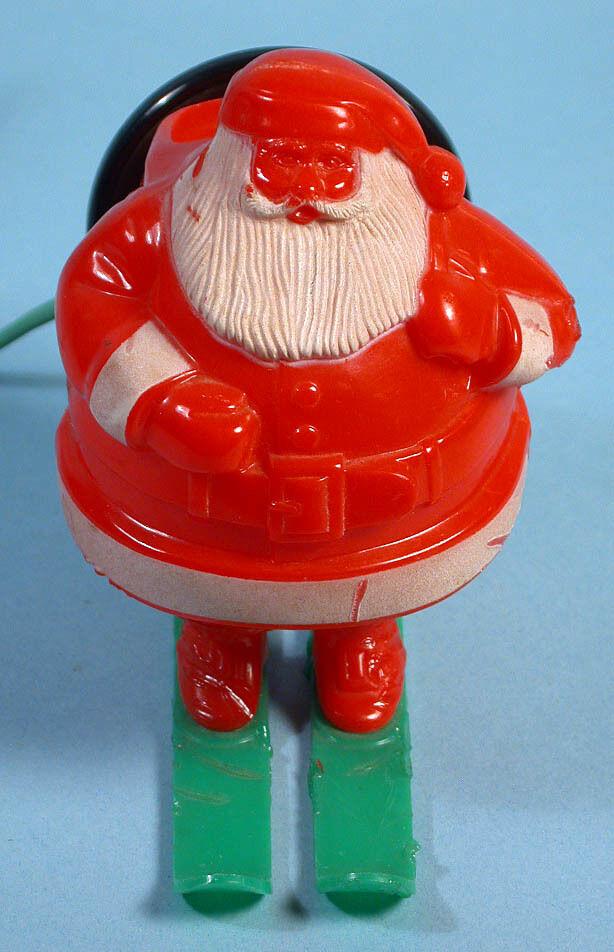 Santa claus on snow skis light up christmas working