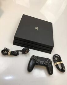 1TB PS4 Pro Console + Controller + Wires