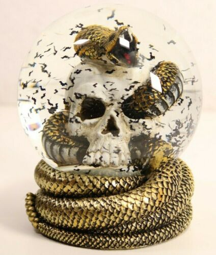 """Skull With Rattle Snake Through Eye And Bats Snow Globe 6"""" Tall x 4.5"""" Wide"""
