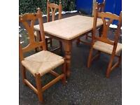 SOLID WOOD PINE TABLE AND 4 CHAIRS