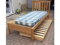 Wooden single bed with spare bed underneath